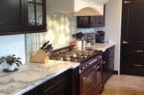Limestone Hood Featured among Walnut Cabinetry